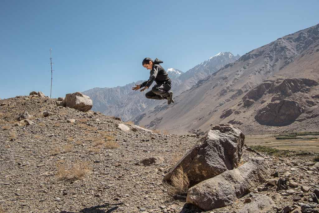 Wakhan, Tajik Wakhan, Wakhan Valley, Wakhan Tajikistan, Wakhan Valley Tajikistan, Tajikistan, Gorno Badakhshan Autonomous Oblast, Badakhshan, GBAO, Pamir, Namadgut, Khaakha, Khaakha fortress, Wakhi boy, Wakhi child, boy jumping
