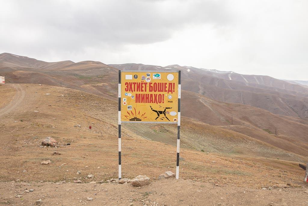 Landmine sign, Sagirdasht Pass, Pamir Highway northern route, Tajikistan